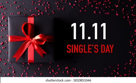 Online shopping of China, 11.11 singles day sale concept. Top view of black christmas boxes with red ribbon on black background with copy space for text 11.11 singles day sale. - Shutterstock ID 1810851046