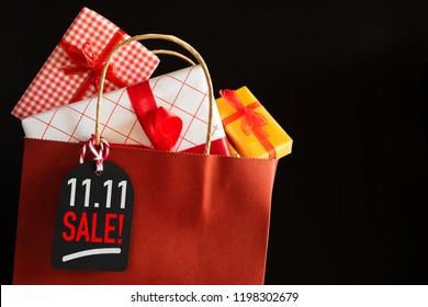 Online shopping of China,single day sale concept. Shopping bag and gifts boxes with message tag.