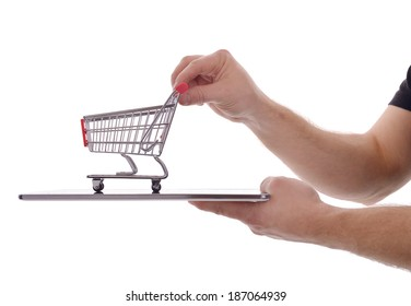 online shopping concept tablet pc with shopping cart isolated on a white background