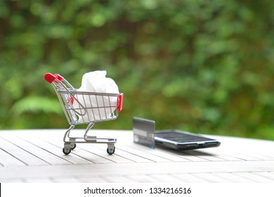 Online shopping concept : trolley on top of a cell phone, with internet purchases can be done with a few clicks