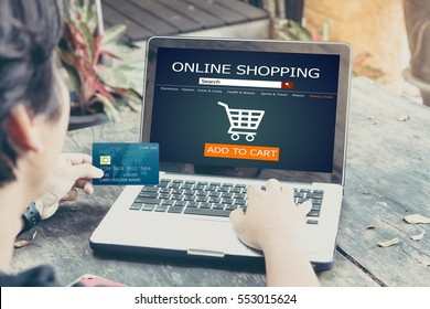Online shopping concept.man using laptop and holding credit card,color filter