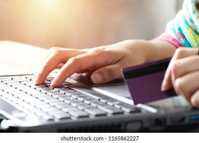 Online shopping concept . Women are buying online with a credit card. Online Shopping Website on Laptop.