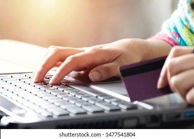Online shopping concept. Women are buying online with a credit card. Soft focus of young woman of freelancer working using laptop computer, Communication technology and Business concept.