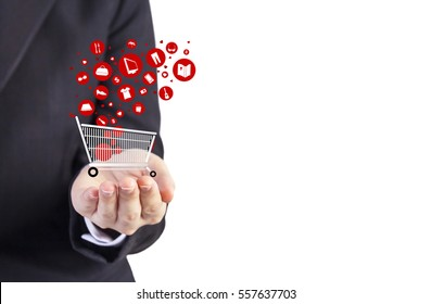 Online shopping concept of young business woman hand holding shopping cart with object icon design