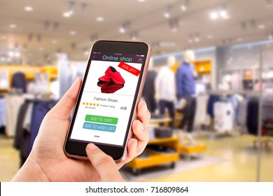 online shopping concept.close-up of hands using touch screen smartphone in department store as background