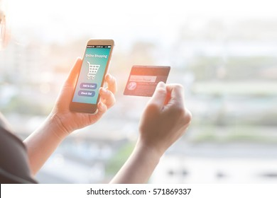 Online shopping concept.Female hands using mobile phone and holding credit card,color filters