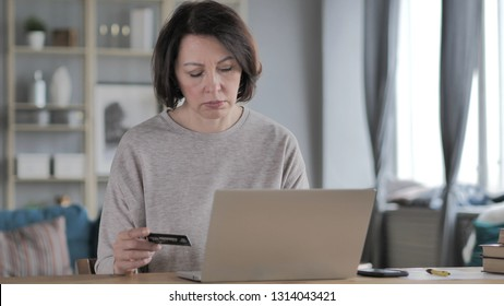 Online Shopping with Credit Card on Laptop
