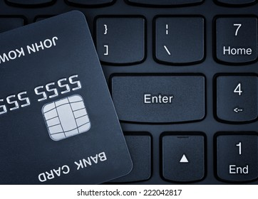 Online shopping. Credit card on a keyboard.