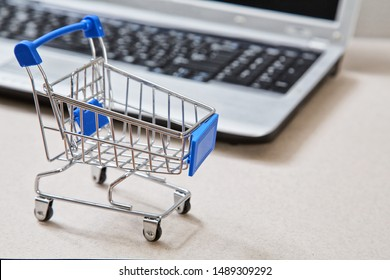 online shopping and e-commerce. Basket and laptop