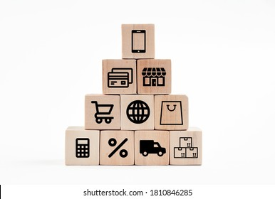 Online shopping or e-commerce concept with online business icons on wooden cubes against white background