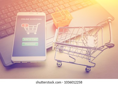 Online shopping / ecommerce and delivery service concept : White smart device runs online shopping app with items in a cart, depicts customers order things from retailer sites by air over the internet