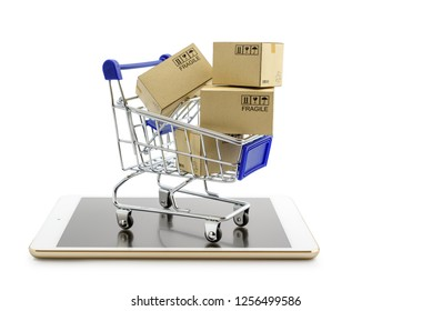 Online shopping or ecommmerce and international freight service concept : Paper boxes with logos in a shopping cart on a white smart mobile phone device. Consumers always shop goods using the internet