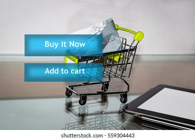 Online shopping. Icons internet shop on the touch screen. Shopping cart with a credit card on the background. Text buy it now, add to cart. E-commerce.