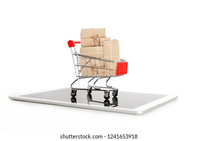 Online shopping and internet shopping delivery, Shopping cart full of boxes on digital tablet, isolated on white background