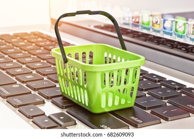 Online shopping, internet purchases and e-commerce concept, green shopping basket on computer laptop keyboard, 3d illustration
