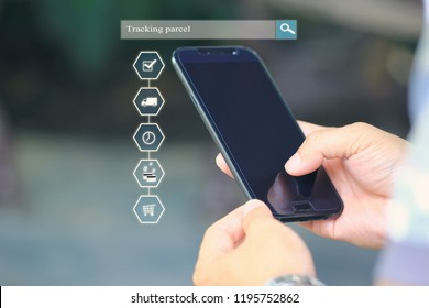 Online shopping, Man hand holding smart phone and tracking parcel online to update status with hologram, Ecommerce and delivery service status tracking concept