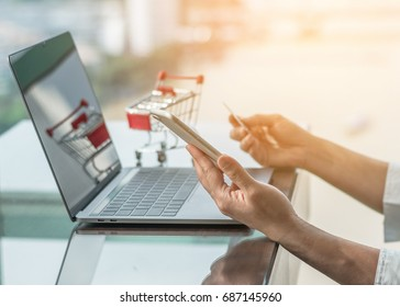 Online shopping marketplace and e-commerce digital marketing concept via computer website, mobile smartphone app and internet wireless communication technology in people at work or shopper lifestyle
