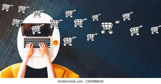 Online Shopping with person using a laptop on a white table