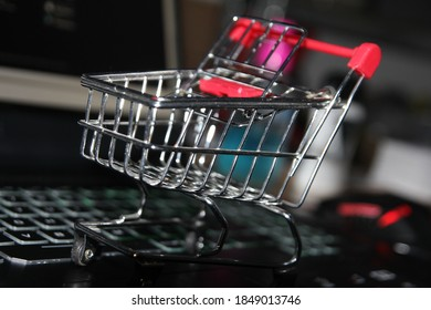Online shopping. Picture of a shopping cart suitable for any digital business