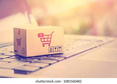 Online shopping / retail ecommerce and delivery service concept : Box with 1 item in a shopping cart sign on a laptop, depicts consumers purchase or order products from suppliers or digital stores.