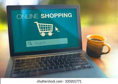 Online shopping searching products from internet with laptop on table