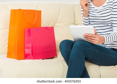 Online shopping. smiling young woman with tablet and credit card