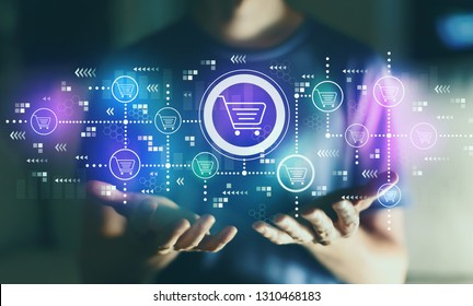 Online shopping theme with young man in the night