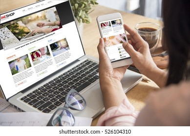 Online Shopping Website on Laptop. Easy E-commerce Website Shop by Smartphone, iPhone, iPad and Laptop. Close up Hands Using Smartphone Shopping Cart Reading Online Article, Blog.