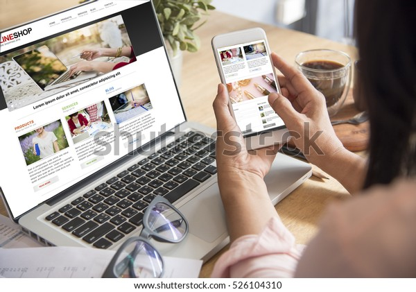 Online Shopping Website on Laptop. Easy E-commerce Website Shop by Smartphone, iPhone, iPad and Laptop. Close up Hands Using Smartphone Shopping Cart read Online Article, Blog. Digital Payment gateway