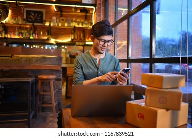 Online shopping young start small business in a cardboard box at work. The seller prepares the delivery box for the customer, online sales, or ecommerce.