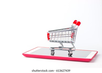 Online shopping.Fast and easy shopping on internet.Shopping cart on Tablet computer or smartphone.