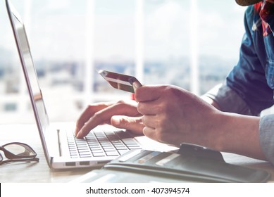Online shopping.Hands holding credit card and using laptop.