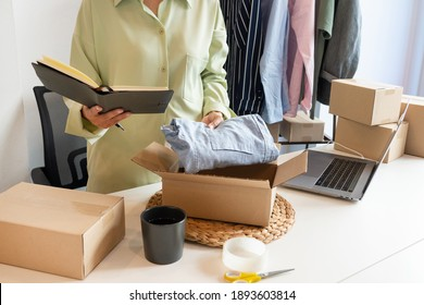Online small business entrepreneur merchants working at store preparing products to deliver to customers, startup and online business concept