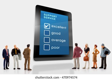 Online support service survey on a digital tablet, with a group of miniature people in