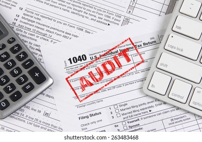Online tax filing - federal 1040 form with computer keyboard and calculator