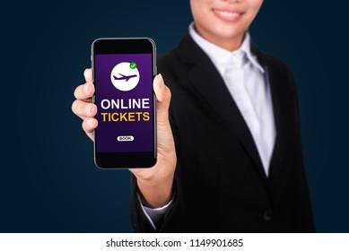 online tickets concept, Happy businesswoman Show text online tickets on smart phone.