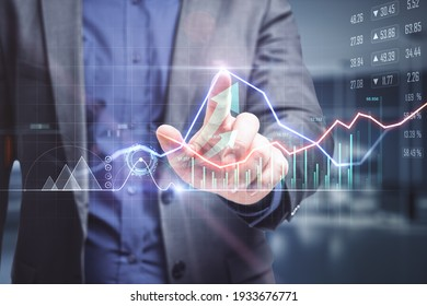 Online trade market concept with businessman analysing financial market on digital screen. Double exposure