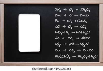 . Online training, chemistry. Tablet on the background of a class board with written chemistry formulas