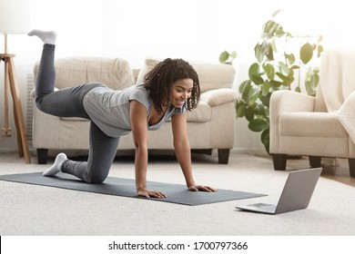 Online Training. Fit Young Woman Excersising At Home, Watching Video Tutorial On Laptop