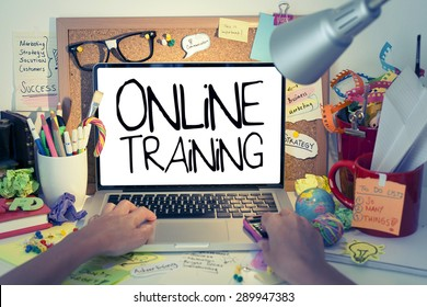Online Training / Internet education concept with hands typing on laptop keyboard in office