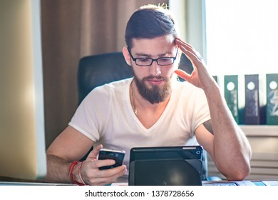 Online training. A man on a tablet is watching educational videos. Education on the Internet. Studen on the tablet studying educational material. Online education.