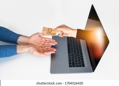 Online transaction. An arm comes out of a laptop to deliver money to a customer or taxpayer. It can represent an online transaction or money gain.