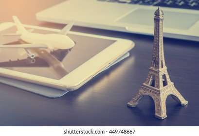 Online travel agency concept with plane on tablet booking to France Paris. Booking online Vacation Flying to Eiffel tower in Europe.