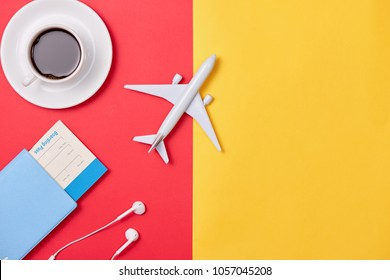 Online travel booking concept. Airplane model and passport on wooden background.