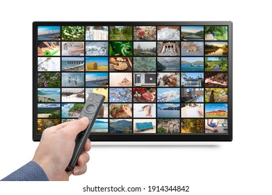 Online TV, Streaming VOD service concept. Male hand holding TV remote control. Television streaming video. Media TV on demand. isolated on white background
