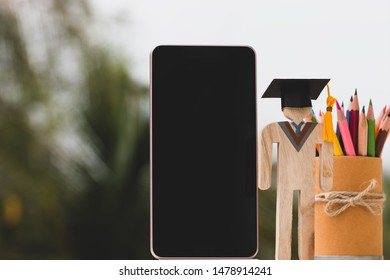 Online university in education knowledge learning achievement for study abroad international, alternative studying idea. Models graduation celebration with smartphone pencils box, copy space for text