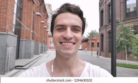 Online Video Chat by Man Walking on Street, Webcam View
