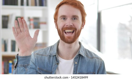 Online Video Chat by Young Casual Redhead Man