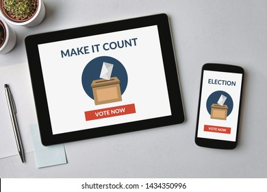 Online voting concept on tablet and smartphone screen over gray table. Flat lay