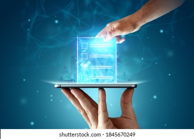 Online voting, Hand with a hologram ballot and a box for Internet voting in a mobile phone on a blue background. Mixed environment, e-voting technology concept